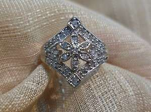 Ladies 10k white gold diamond flower estate looking ring size 6