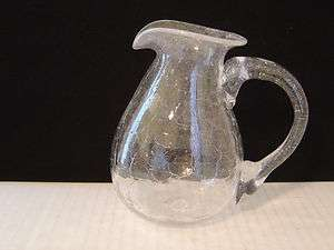CLEAR CRACKLE GLASS SMALL PITCHER HAND SIGNED ON BOTTOM |