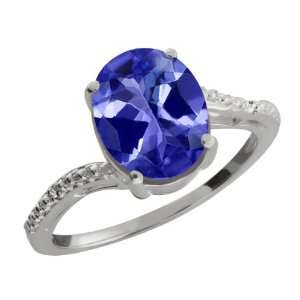 61 Ct Oval Sapphire Blue Mystic Topaz and Diamond Sterling Silver Ring