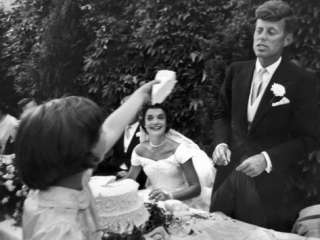 Flower Girl Janet Auchincloss Holding Up a Wedge of Wedding Cake for