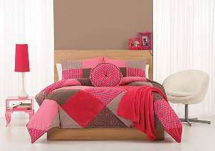 pink and white kids room with plush childrens bedding