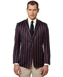Wool twill. Three button roll over lapel, with center back vent and
