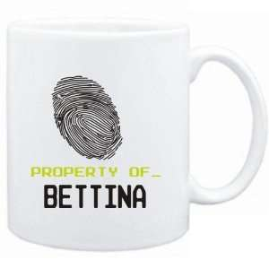Mug White  Property of _ Bettina   Fingerprint  Female