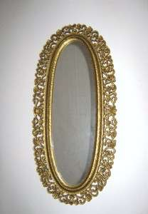 Vintage 1969 Oval Wall Mirror With Molded Gold Plastic Frame   USA